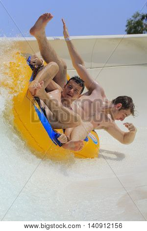 Rhodes Greece-July 31,2016: Two boys on the rafting slide in the Water park.Rafting slide is one of many popular game for adults and children in park. Water Park is located on the island of Rhodes in Greece and one of the largest in Europe