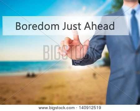 Boredom Just Ahead - Businessman Hand Touch  Button On Virtual  Screen Interface