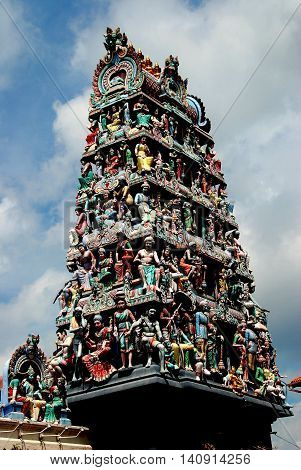 Singapore - December 14 2007: Sikhara tower with 72 statues of gods goddesses and mythological beasts at the entrance to 1827 Sri Mariamman Hindu Temple on South Bridge Road in Chinatown