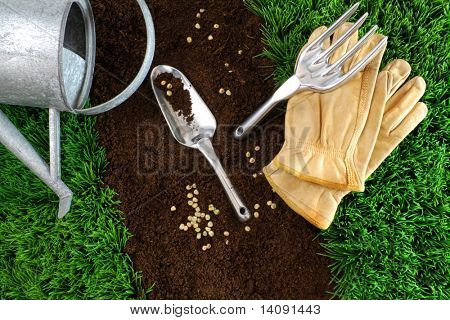 Assortment of garden tools with earth and grass