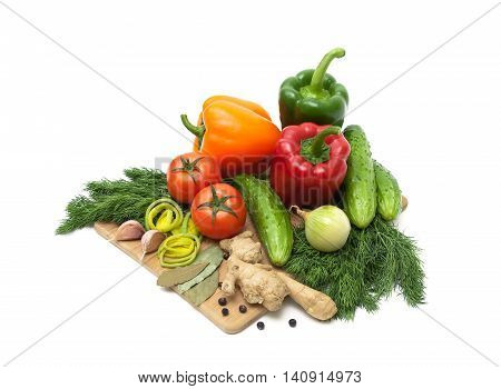 Fresh vegetables and herbs on a cutting board. white background - horizontal photo.