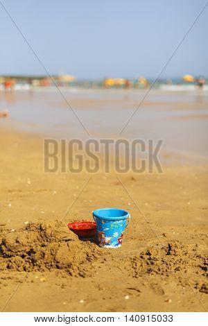 bucket on the beach and wet sand