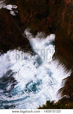 landscape whit Ocean waves that break rock