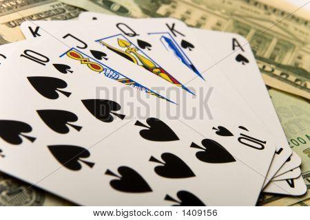 Poker Winning Hand Over Dollar Bills