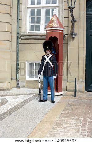 COPENHAGEN, DENMARK - JULY 13, 2016: A Royal guard on duty, Amalienborg Palace home of the Danish Royal family, Copenhagen, Denmark