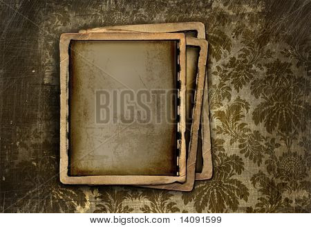 Vintage photo frames on grungy floral background