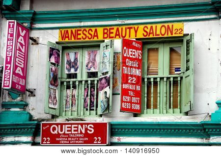 Singapore - December 17 2007: Two Indian businesses a beauty salon and tailor occupy a shop house on Buffalo Road in Little India