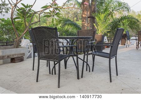 Close up Chairs and table beautiful view in garden the evening soft-focus background