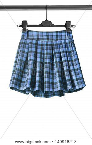 Tartan pleated skirt on clothes rack isolated over white