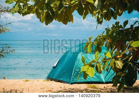 Photo of the Camping Tent on Beach. Concept tourism active rest