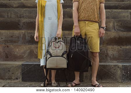 Photo of the Concept traveling together honeymoon. Stylish couple in love with backpacks standing on footstep