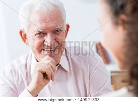 Senior Man Smiling To Young Woman
