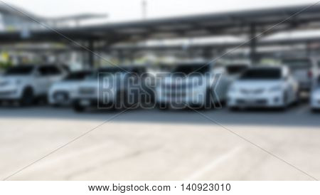 blur image of car park in outdoor parking with copy space for background usage