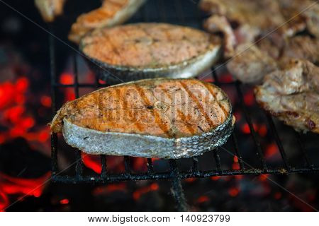 Salmon Preparation Process On Wooden Grill. Grilled Fish Steaks On Fire. Top View