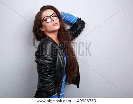 Sexy Woman Posing In Fashion Black Leather Jacket And Eye Glasses On Blue Background With Empty Spac