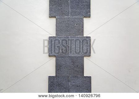 Placing styrofoam sheet insulation to wall at construction site