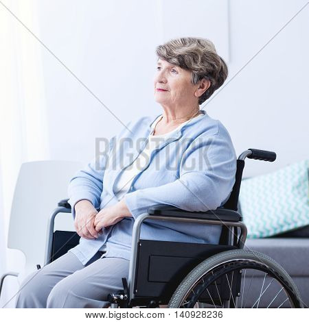 Disabled Old Woman On Wheelchair