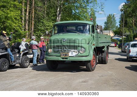 KERIMYAKI, FINLAND - JUNE 06, 2015:Truck Mercedes Benz 1113 arrives at the parade of vintage cars. Tourist landmark of the city Kerimyaki, Finland