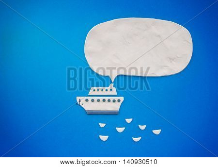 White ship with bubble speech on a blue background, illustration