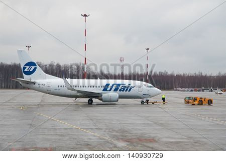 ST. PETERSBURG RUSSIA - DECEMBER 12 2015: A Boeing 737-500 (VQ-BJQ) UTair airline is preparing to fly to Pulkovo airport