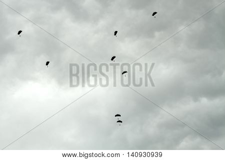 Parachutists Siluets In Sky