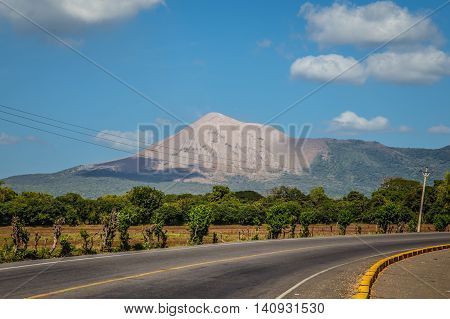 Telica volcano view from Nicaragua with road and blue sky
