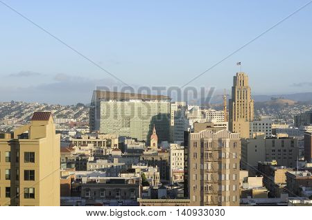 The city of San Francisco California as seen in the setting sun.