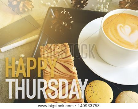 Happy Thursday word on coffee with dessert background