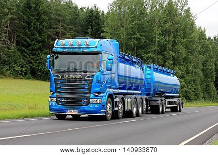 SALO, FINLAND - JULY 22, 2016: New blue Scania R580 tank truck for bulk transport moves along summer highway in South of Finland.