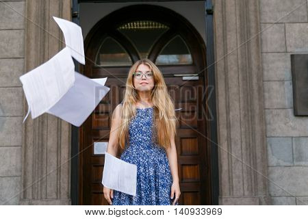 Young woman threw the papers in casual and paper flying in air. Freedom concept