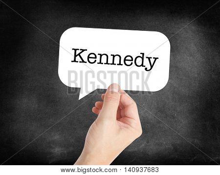Kennedy written in a speechbubble