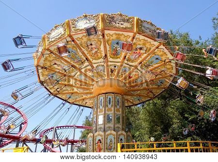 ALMATY KAZAKHSTAN - AUGUST 2 2016: The Fantasy Amusement park located in Almaty Kazakhstan. People ride and get the adrenaline.