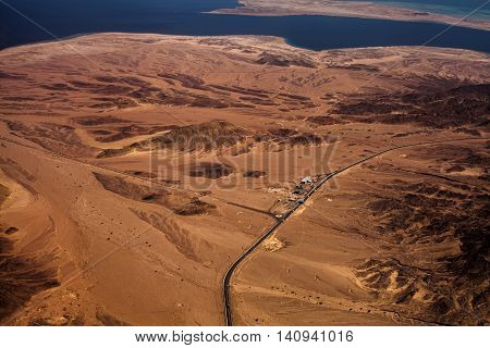 Photo of desert with check point and hot climate