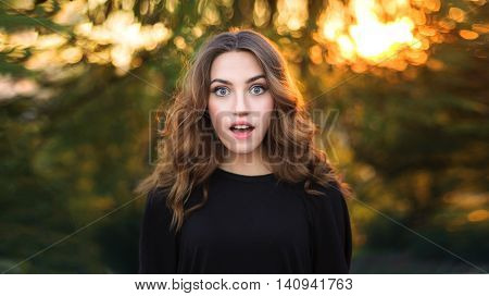 Beauty Surprised Teenager Model Girl on Nature Background.