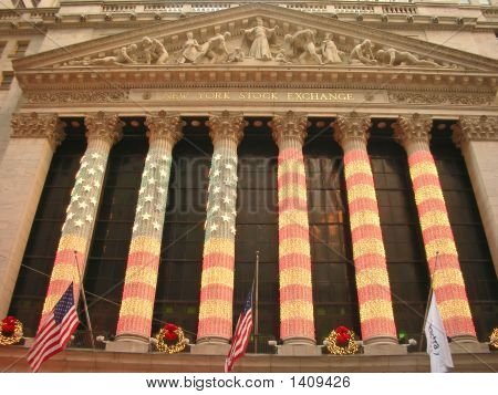 New York Stock Exchange With Us Flags On The Pillars