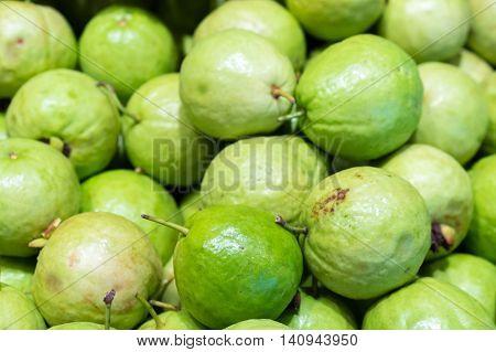 Image of pile of fresh guavas background