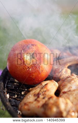 Chicken Wings With Tomato On The Grill