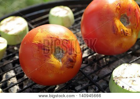 Tomatoes And Zucchini On Grill Grate