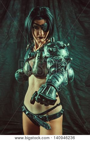 Powerful One-eyed Steam Punk Woman In Metal Lingerie.