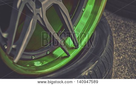 Closeup Detail Of Green Aluminum Car Wheel