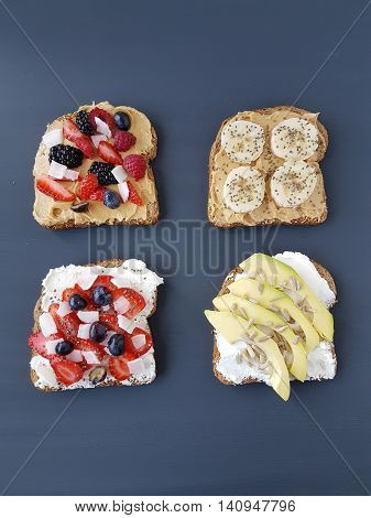 sandwiches with peanut butter and cheese, banana,avocado,berries