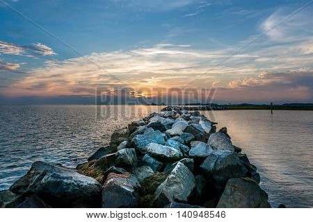 Sunset over a rocky jetty on the Chesapeake Bay in Maryland