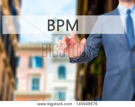 Bpm (business Process Management) - Businessman Hand Touch  Button On Virtual  Screen Interface