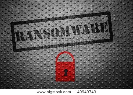 Ransomware stamped on metal with red lock -- cyber crime concept