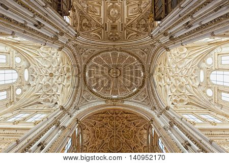 Cordoba, Spain - May 2, 2016: View up to the vault of famous Mesquita-Cathedral at Cordoba