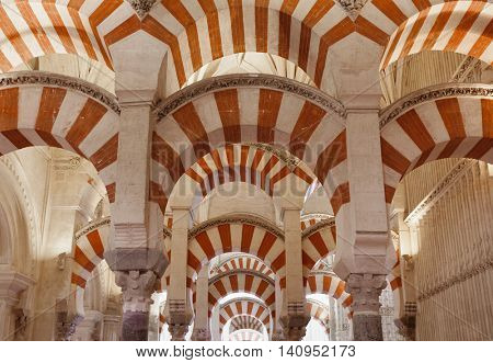 Cordoba, Spain - May 2, 2016: Interior view with columns at the famous Mosque-Cathedral of Cordoba