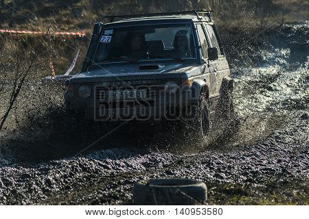 LvivUkraine- December 6 2015: Off-road vehicle brand Mitsubishi Pajero overcomes the track on a polygon near the city Lviv Ukraine