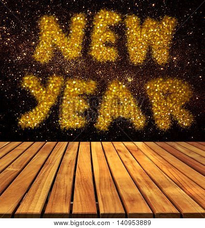 old wood table top on wall with word new year on galaxy wall background
