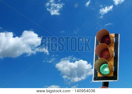 close up shot of traffic light and green light .