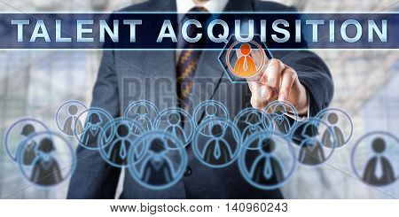 Recruiter is pushing TALENT ACQUISITION on an interactive virtual display. Business concept involving temporary or permanent employment recruitment challenges and human resource management.